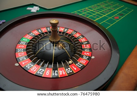 Picture of a roulette and a green table