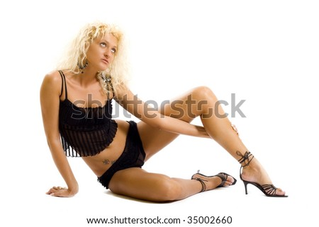 picture of a seated blond woman looking to a side - stock photo