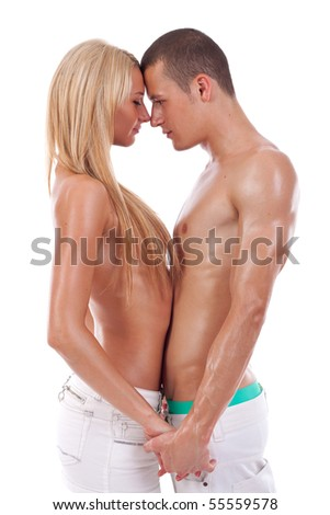 picture of a sexy couple holding hands and standing face to face - stock photo