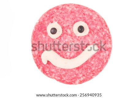 Picture of a single danish salami slice with a cheese smile - stock photo