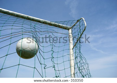 Picture of a soccer ball hitting the target - stock photo