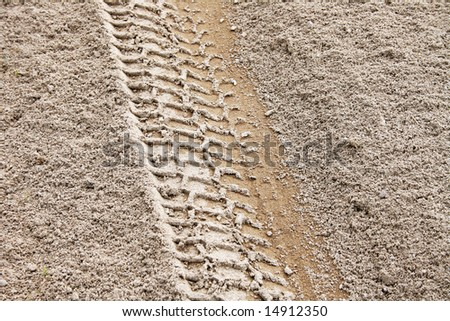 Picture of a tire track left on the sand