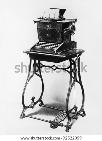 Picture of a typewriter on a stand