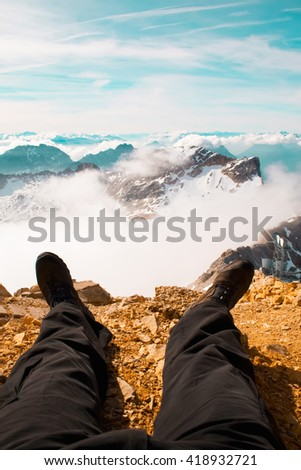 Picture of a walkers legs with a beautiful back drop of the Austrian Alps