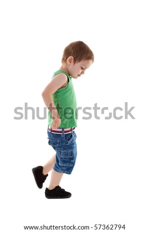 picture of a walking small boy, over white background - stock photo