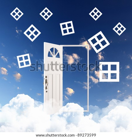 Picture of a white door against blue sky background