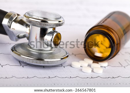 Picture of a whitel pills capsules and stethoscope - stock photo