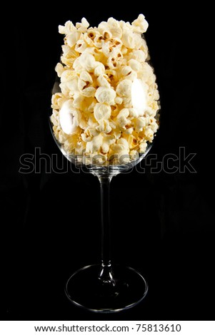 Picture of a wine glass with popcorn