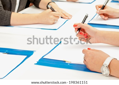 picture of a woman's hand signing the contract on - stock photo