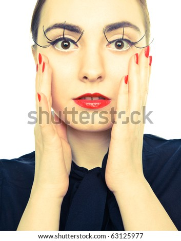 Picture of a woman with red lips and nails looking to the camera