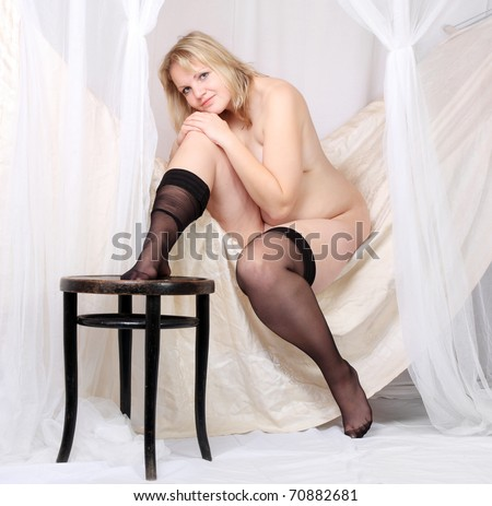 Picture of a worry overweight woman in a vintage bedroom. - stock photo