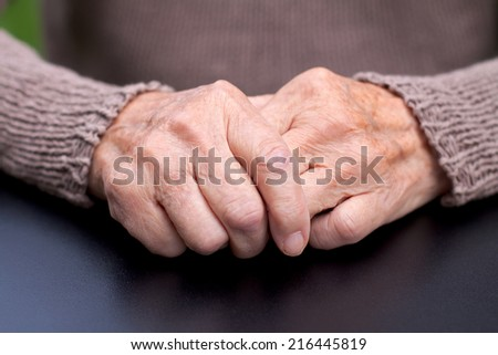 Picture of a wrinkled elderly hand - stock photo