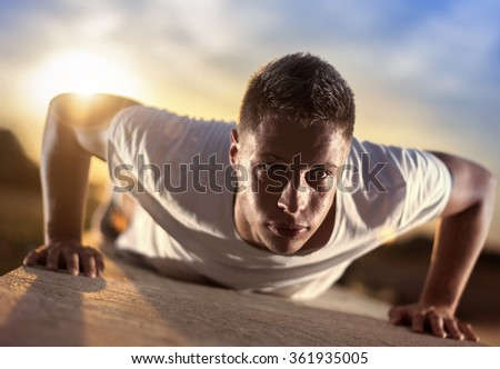Picture of a young athletic man doing push ups outdoors.Keeping fit for a healthy mind and body.