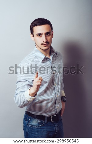 picture of a young businessman pushing an imaginary button - stock photo
