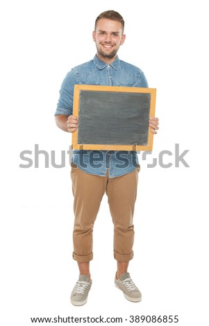 picture of a young casual man holding a blank blackboard and smiling for the camera. isolated on a white background - stock photo