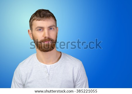 picture of a young casual man looking suspiciously