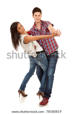 picture of a young couple dancing over white background - stock photo