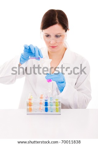 Picture of a young female researcher carrying out experiments, isolated on white