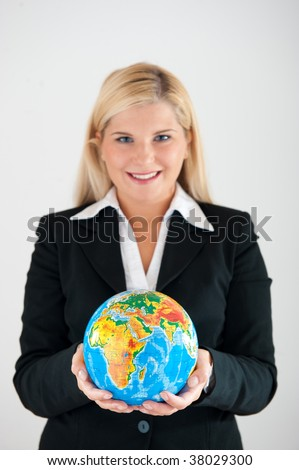 Picture of a young friendly beautiful female office worker in a suit holding a globe - stock photo