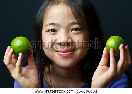 Picture of a young girl looking at the camera - stock photo