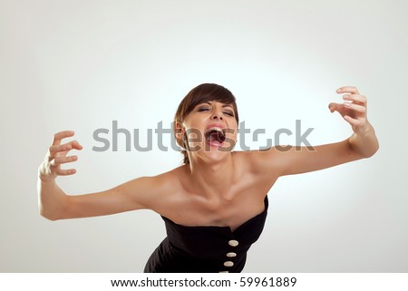 picture of a young woman in fashion black dress screaming