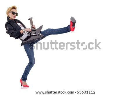 picture of a young woman kicking and playing an electric guitar - stock photo