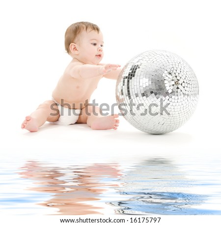 picture of adorable baby boy with big disco ball - stock photo