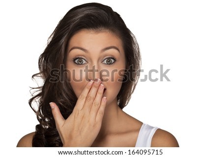 picture of amazed brunette girl with hand over mouth isolated over white background - stock photo