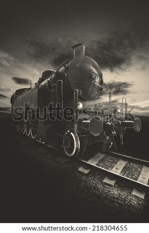 Picture of an ancient locomotive with brown tones - stock photo