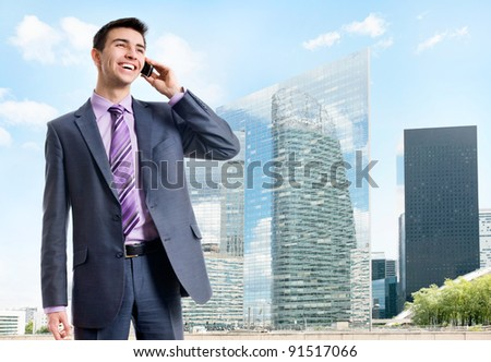 Picture of an attractive businessman talking on a cell phone. - stock photo