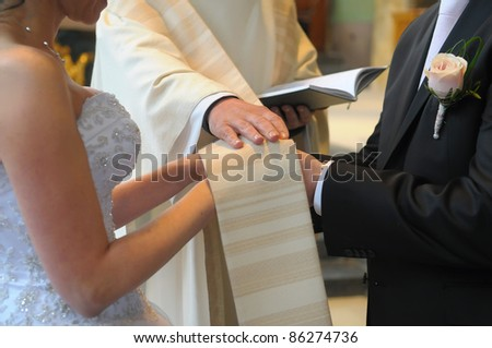 Picture of an engagement couple in a front of the priest - stock photo