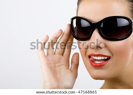 picture of an excited young woman with black sunglasses - stock photo
