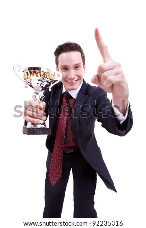 picture of an excited younh business man winning a nice tropy on white background - stock photo