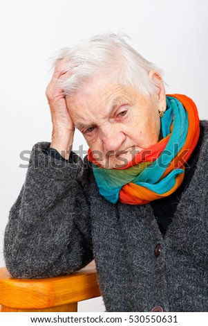 Picture of an ill elderly woman beling lonely