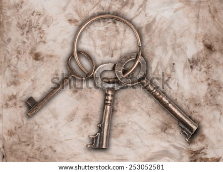 picture of an old keys on a brown background - stock photo
