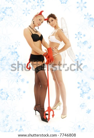 picture of angel and devil girls with snowflakes - stock photo