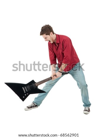 Picture of angry man holding a guitar and trying to break it , isolated - stock photo