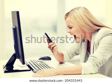 picture of angry woman shouting at phone - stock photo