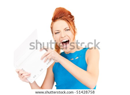 picture of angry woman with laptop computer - stock photo