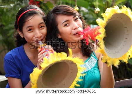 picture of asian teenagers celebrating New Year - stock photo