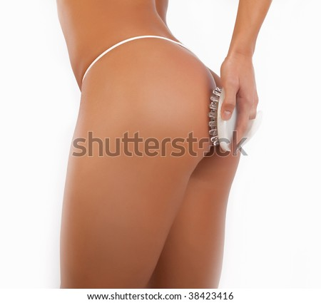 Picture of ass of sexy girl isolated on white. Massage procedure