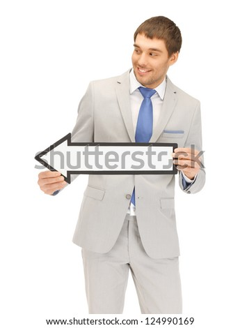 picture of attractive businessman with direction arrow sign......