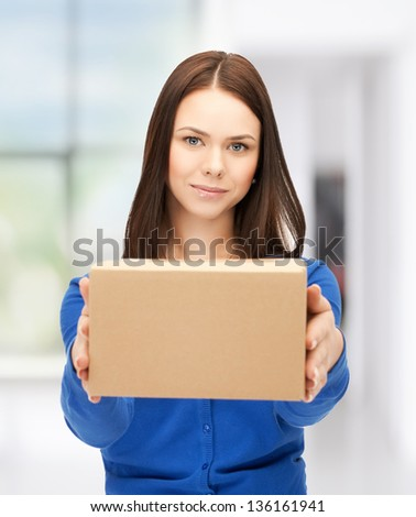 picture of attractive businesswoman delivering box - stock photo