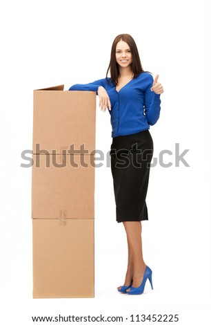 picture of attractive businesswoman with big boxes.. - stock photo
