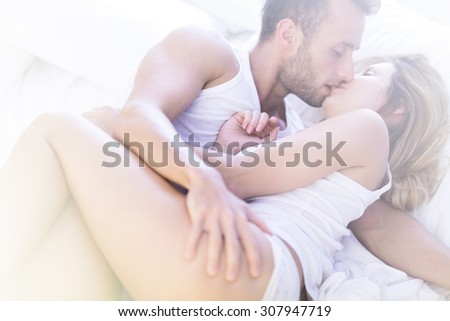 Picture of attractive man and woman kissing with passion - stock photo