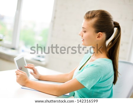 picture of attractive student girl using tablet pc - stock photo