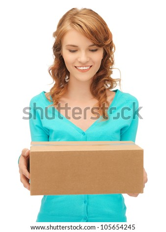 picture of attractive teenage girl with cardboard box - stock photo