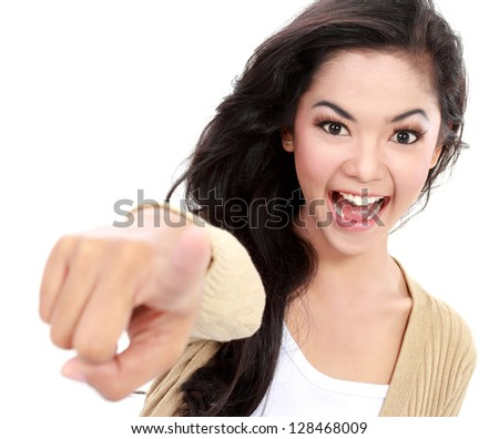 picture of attractive teenager pointing her finger at camera - stock photo