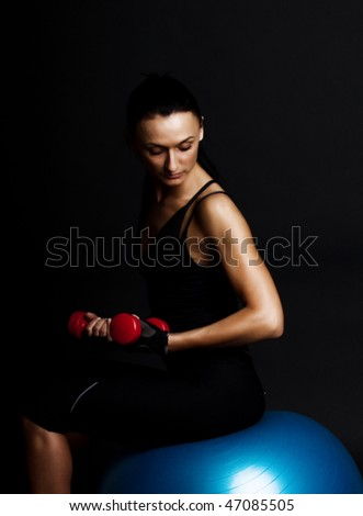 Picture of attractive woman doing exercise with dumbbells - stock photo