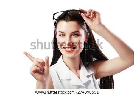 picture of attractive young woman with her finger pointing to copyspace - stock photo